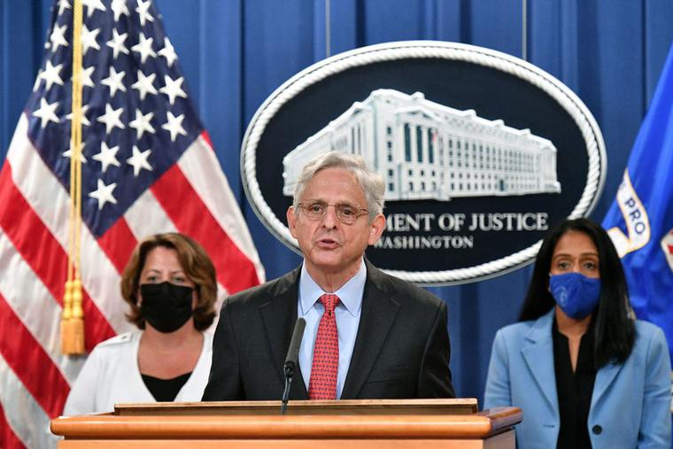 U.S. Attorney General Merrick Garland (c), Deputy Attorney General Lisa O. Monaco (l) and Associate Attorney General Vanita Gupta (r) hold a news conference to announce a lawsuit against Texas at the Department of Justice in Washington on Sept. 9.