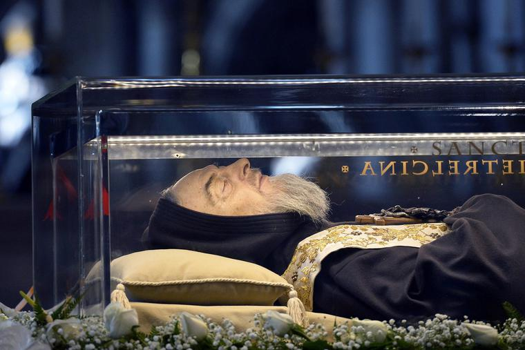 The body of Padre Pio, who died in 1968 and was canonized in 2002, is displayed Feb. 6, 2016, for veneration in St. Peter's basilica at the Vatican.