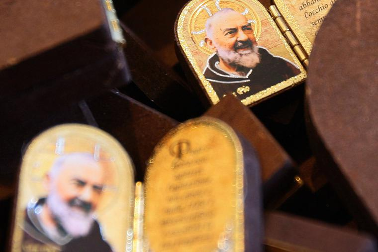 Diptychs of Padre Pio are displayed at a religious gift store at San Giovanni Rotondo in the Puglia region in southern Italy on April 23, 2008 on the eve of the public exhibition of the saint's body.