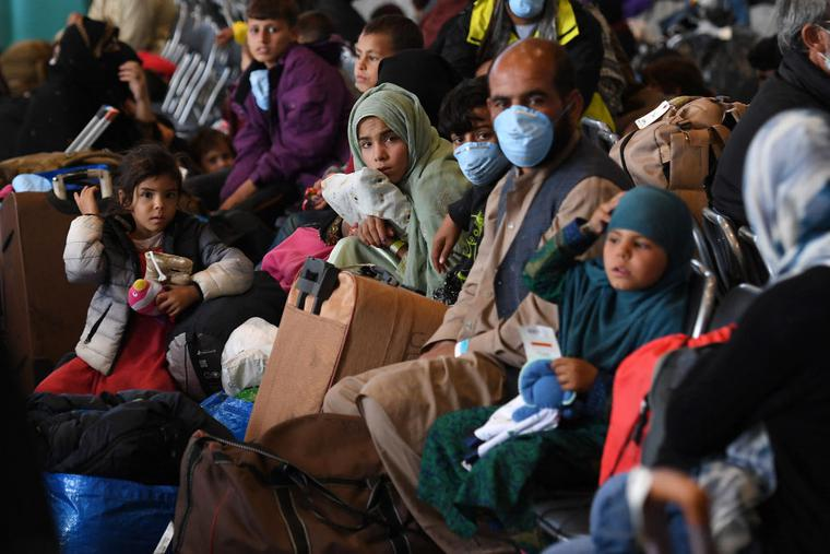Afghan refugees are being processed inside Hangar 5 at Ramstein Air Base in Germany on Sept. 8.