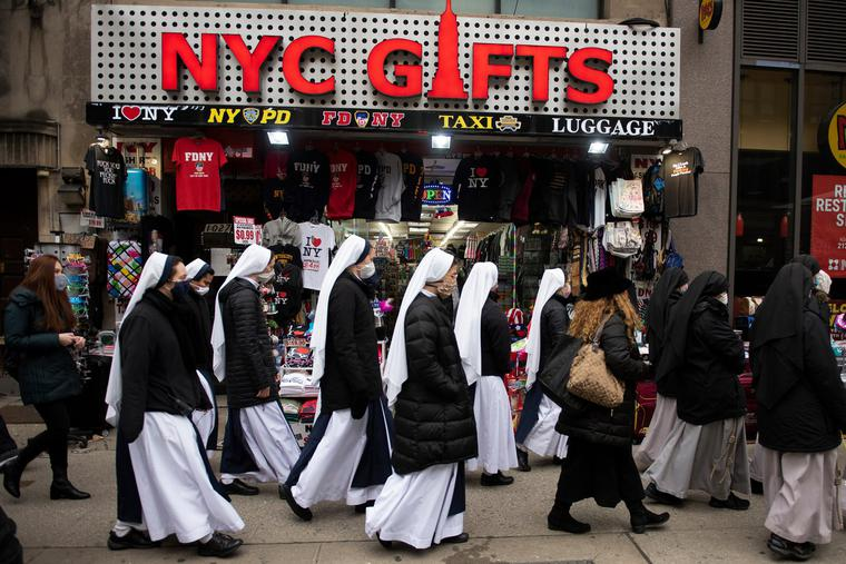 """""""NYC Gifts"""" — Sisters of Life walk up Seventh Avenue in Manhattan on their way to Mass at Old St. Patrick's Cathedral, from where they would process with others to the Margaret Sanger Planned Parenthood for a monthly witness. The monthly prayer and sidewalk counseling at the abortion center continued through the pandemic, as did the abortions. The religious order was founded in the Archdiocese of New York 30 years ago by Cardinal John O'Connor."""