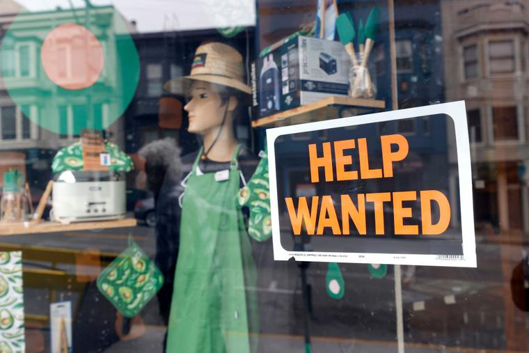 A help wanted sign is posted in the window of hardware store on September 16, 2021 in San Francisco, California.