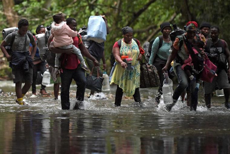 Haitian migrants cross the jungle of the Darien Gap, near Acandi, Choco department, Colombia, heading to Panama, on September 26, 2021, on their way trying to reach the US.