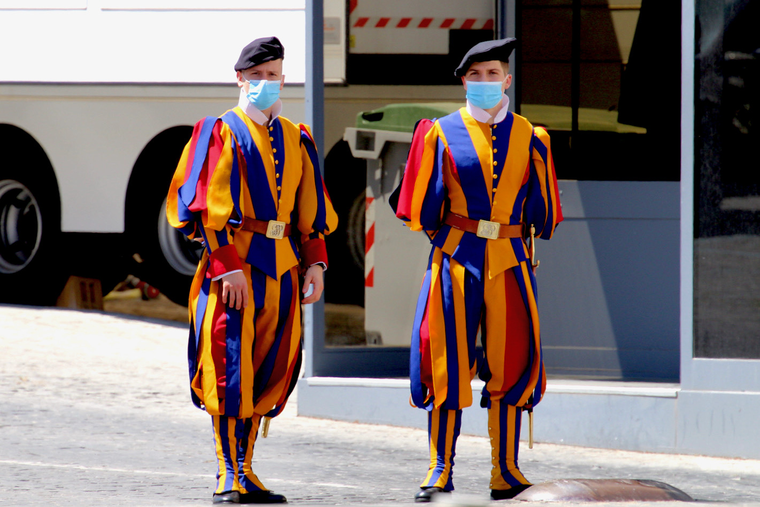 Two Swiss guards pose for a photo wearing masks amid the COVID pandemic.