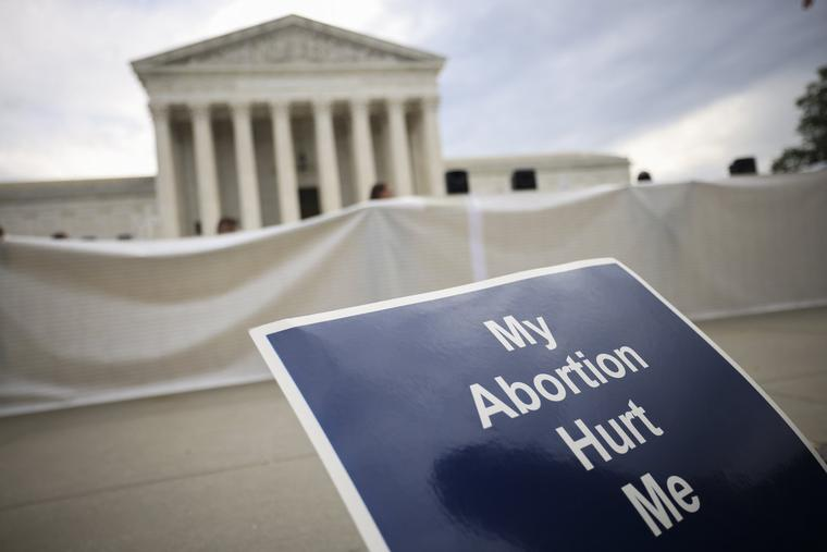 Anti-abortion activists demonstrate outside the U.S. Supreme Court building Monday in Washington, DC.