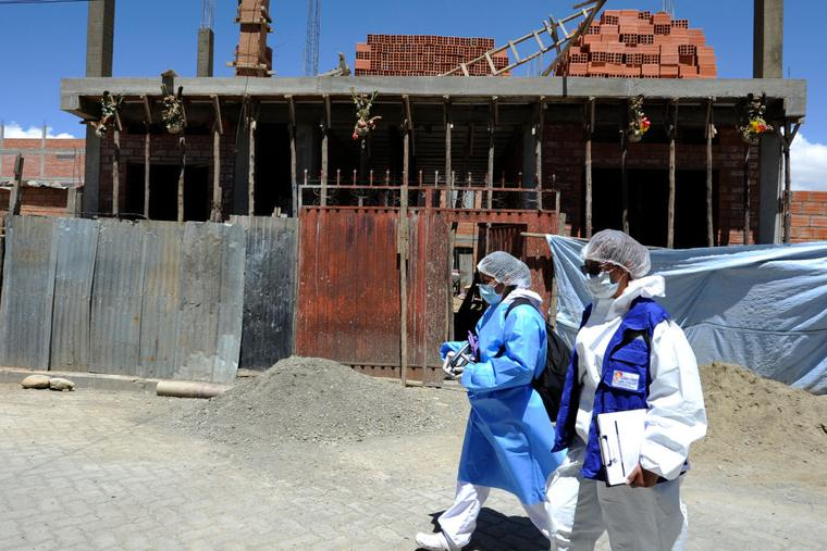 Health personnel of the Bolivian Health Ministry walk at Santa Rosa neighborhood to vaccinate people against COVID-19 home by home in El Alto, Bolivia, on September 17, 2021.