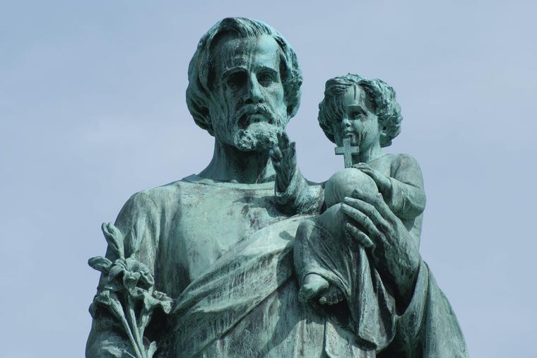 Statue of St. Joseph holding the Child Jesus.