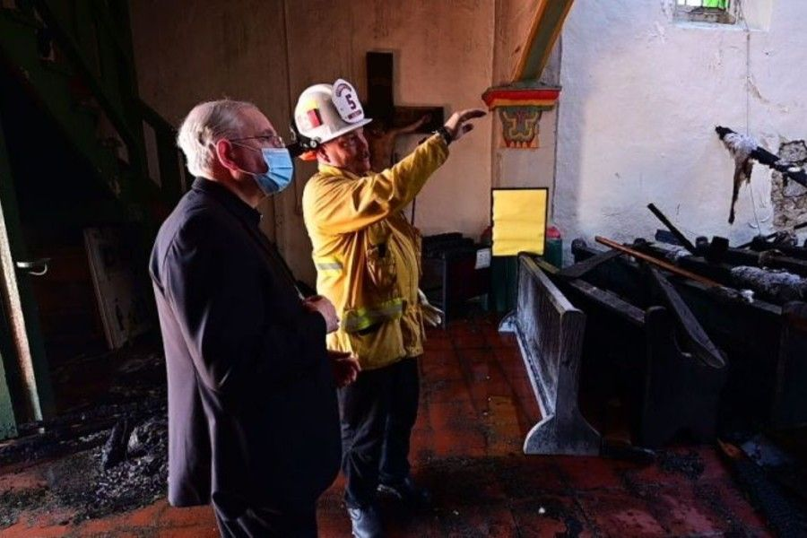Archbishop Jose Gomez of Los Angeles visits the scene of the fire at Mission San Gabriel church, July 11, 2020.