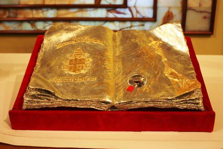 This golden book contains a first-class relic of Pope St. John Paul II