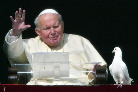 Pope John Paul II blesses the pilgrims gathered at St. Peter's square after he released two doves from the window of the papal apartments at the end of his weekly Angelus prayer, Jan. 25, 2004, at the Vatican.