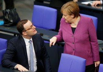 Jens Špan, Angela Merkel