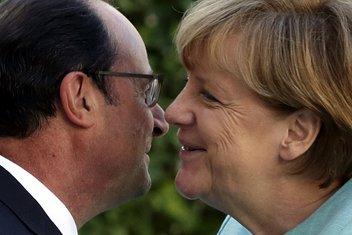 Fransoa Oland, Angela Merkel