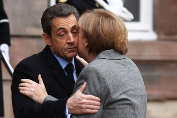 Nikola Sarkozi i Angela Merkel