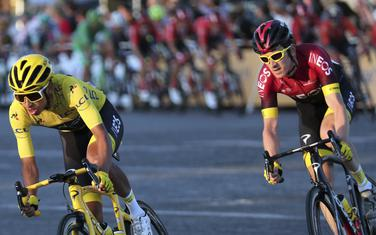 Colombia's Egan Bernal wearing the overall leader's yellow jersey, rides with Britain's Geraint Thomas on the Champs-Elysees during the twenty-first stage of the Tour de France cycling race over 128 kilometers (79.53miles) with start in Rambouillet and finish in Paris, France, Sunday, July 28, 2019. (AP Photo/Thibault Camus)