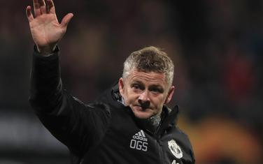 Manchester United's manager Ole Gunnar Solskjaer waves goodbye to fans after the group L Europa League soccer match between AZ Alkmaar and Manchester United at the ADO Den Haag stadium in The Hague, Netherlands, Thursday, Oct. 3, 2019. (AP Photo/Peter Dejong)