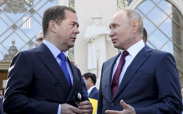 Russian President Vladimir Putin, right, talks to Prime Minister Dmitry Medvedev during Moscow City Day celebrations, in Moscow, Russia, on Saturday, Sept. 7, 2019. (Ekaterina Shtukina, Sputnik, Kremlin Pool Photo via AP)