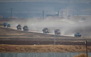 Turka i ruska vojna vozila se vraćaju iz zajedničke patrole na sjeveroistoku Sirije